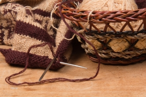 knitting needles and basket