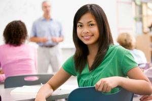 A schoolgirl  in a high school class