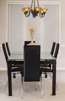 Dining Room with Glass Table and Leather Chairs